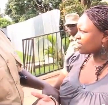 Woman detained by police at LGBT workshop on June 18. (Photo courtesy of NTV. Click photo to see video.)