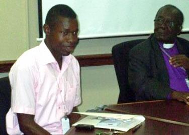 Ugandan activists Danie Herbert and Bishop Christopher Senyonjo meet with State Department staff.