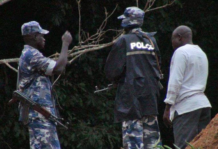 "Police arrive to break up Ugandan ""Beach Pride"" event on Aug. 4. (Photo by David Robinson)"