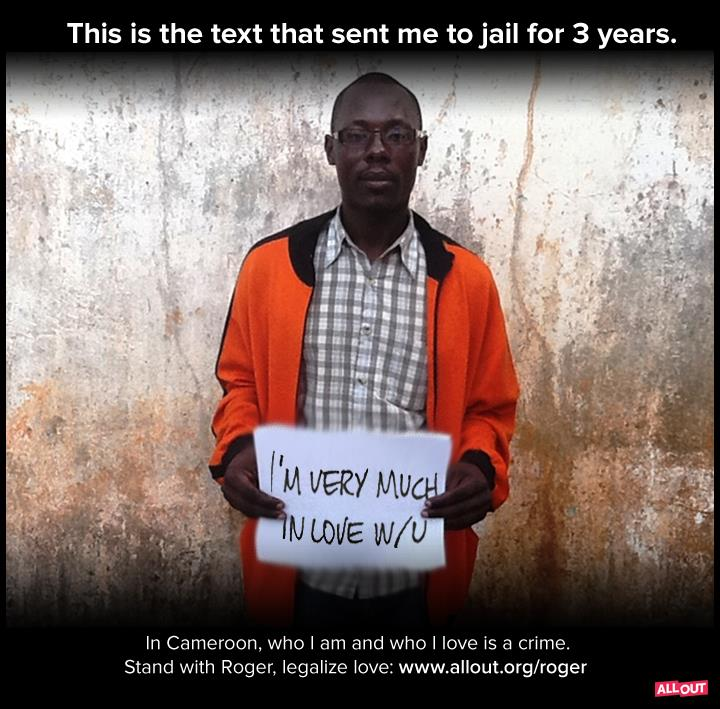 Jean-Claude Roger Mbede displays the text message that led to his 3-year prison sentence. (Photo courtesy of allout.org)