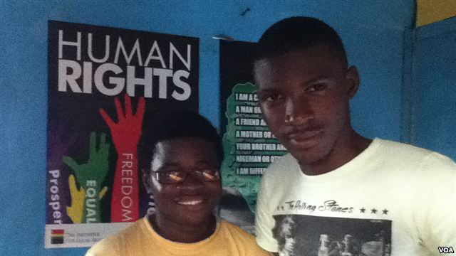 George Freeman (left) and co-worker Bernard Wilson at their office in Freetown, Sierra Leone (Photo courtesy of VOA)