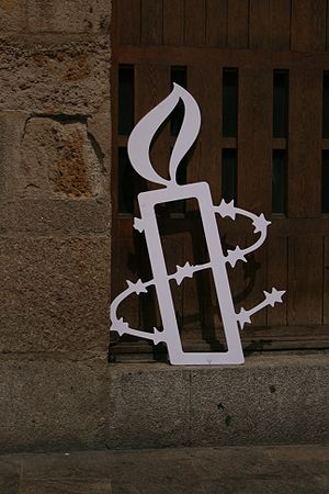 Amnesty International's candle-and-barbed-wire symbol. (Photo courtesy of Wikipedia)