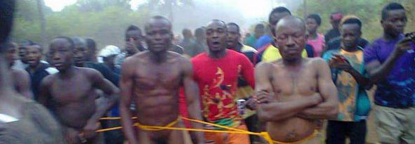 Reported photo of three men seized, stripped and beaten Jan. 14 by Nigerian mob. (Photo courtesy of IdentifyKenya)