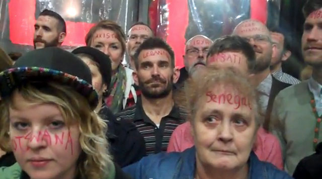Protesters had their faces painted with the names of 76-plus countries with anti-LGBT laws. (Click image to see the video.)