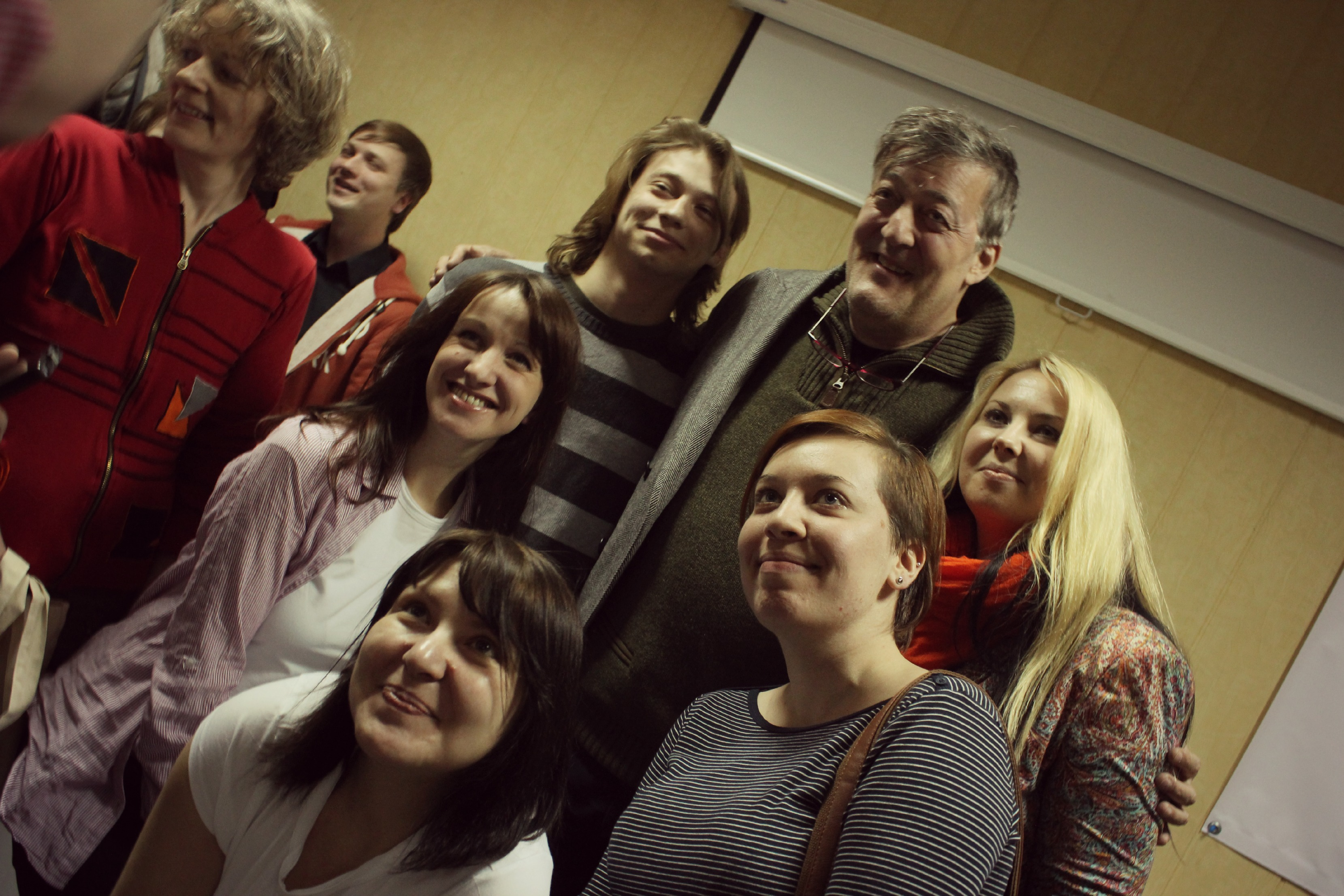 Stephen Fry poses with LGBT activists in St. Petersburg, Russia. (Photo courtesy of  ComingOutSPB.ru)