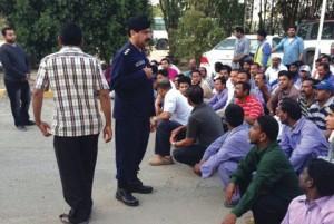 """Kuwait TImes photo of """"illegals"""" under arrest."""
