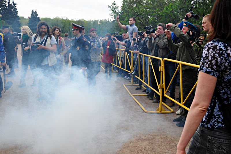 Anti-gay protesters threw smoke pellets, insults and small rocks at the LGBT rights demonstrators. (Photo by Olga W)