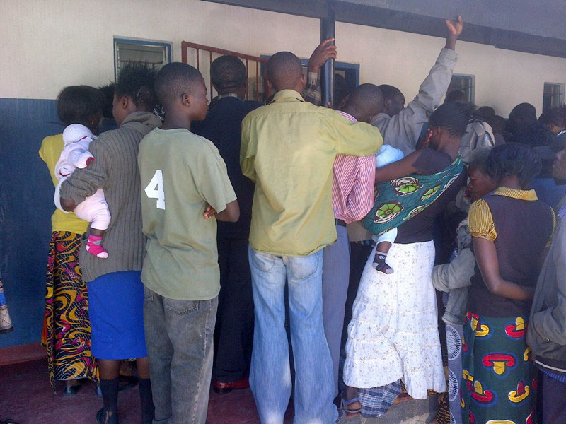 Members of the public gather outside the courtroom in Kapiri Mposhi, Zambia.