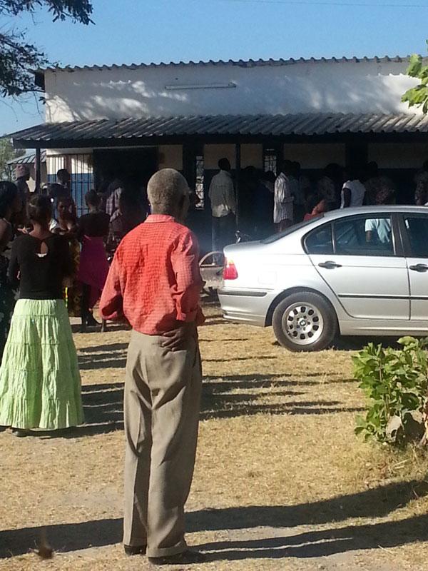 Spectators gather outside the Kapiri Mposhi courtroom.