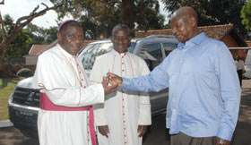President Yoweri Museveni donates at vehicle to a new Anglican bishop. (Photo courtesy of Integrity)