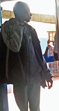 In chains, Philip Mubiana and James Mwape enter the Kapiri Mposhi courtroom.