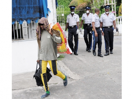 Police evicted gay men from abandoned house  in an upscale neighborhood of Jamaica. (Photo courtesy of Jamaica Gleaner)
