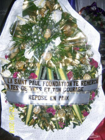 "Flowers honoring slain activist Eric Lembembe state, ""The St. Paul's Foundation thanks you for your work and your courage. Rest in peace."" (Photo courtesy of Camfaids)"