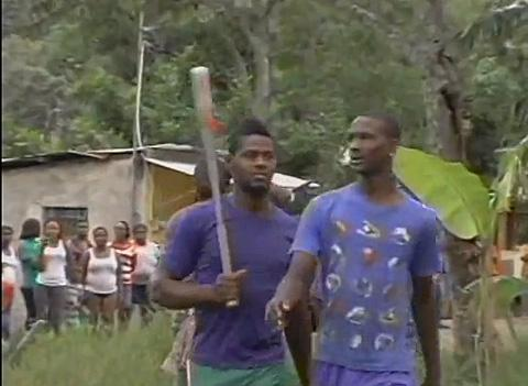 Jamaican mob barricades five allegedly gay men in their house. (Photo from video)
