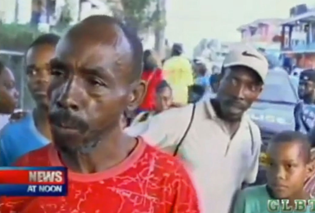 In Old Harbour, Jamaica, crowd tells news reporter that gays must go away. (Click image for the video on YouTube.)