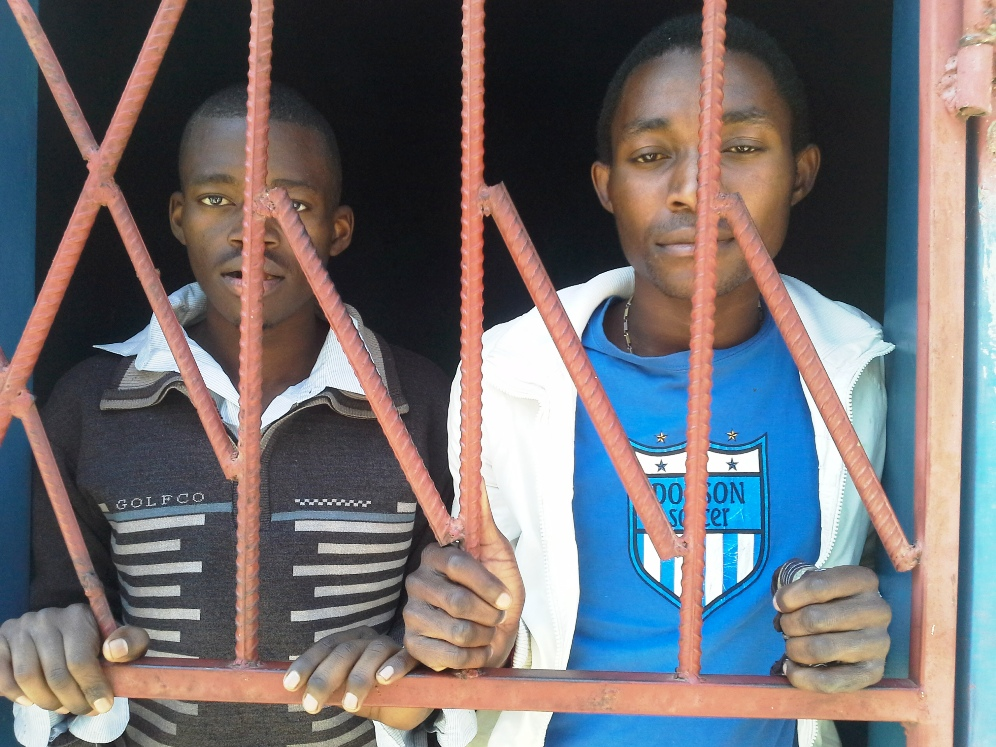 Jailed in Zambia for nearly five months on homosexuality charges, defendants James Mwape and Philip Mubiana wait in the cell as their trial falters because witnesses have other engagements.