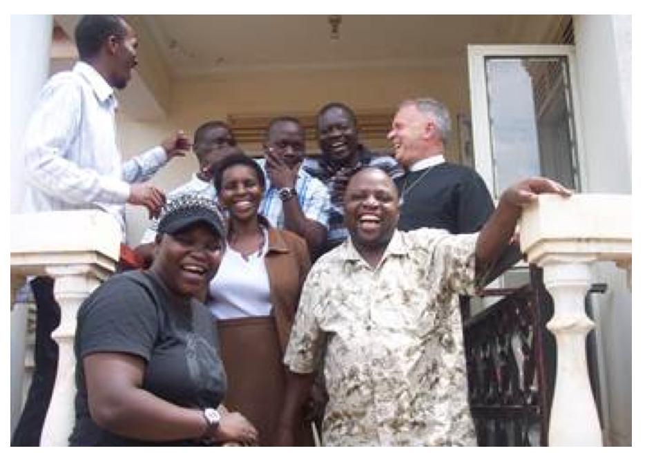 The Rev. Canon Albert Ogle with the Executive Committee of the Good Samaritan Consortium in Uganda.