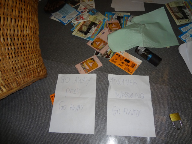 Vandals who burglarized CAMEF office left behind these threatening messages. (Photo by a neighbor, provided by CAMEF.)