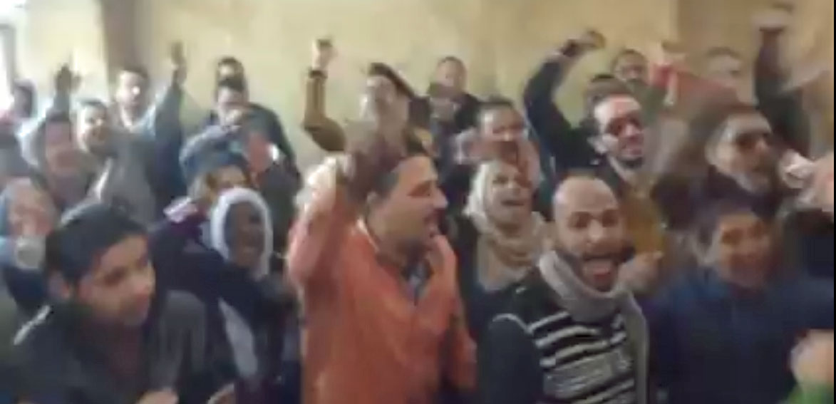 Families and supporters of acquitted defendants celebrate after Cairo court decision. Click image for video. (Photo courtesy of YouTube)