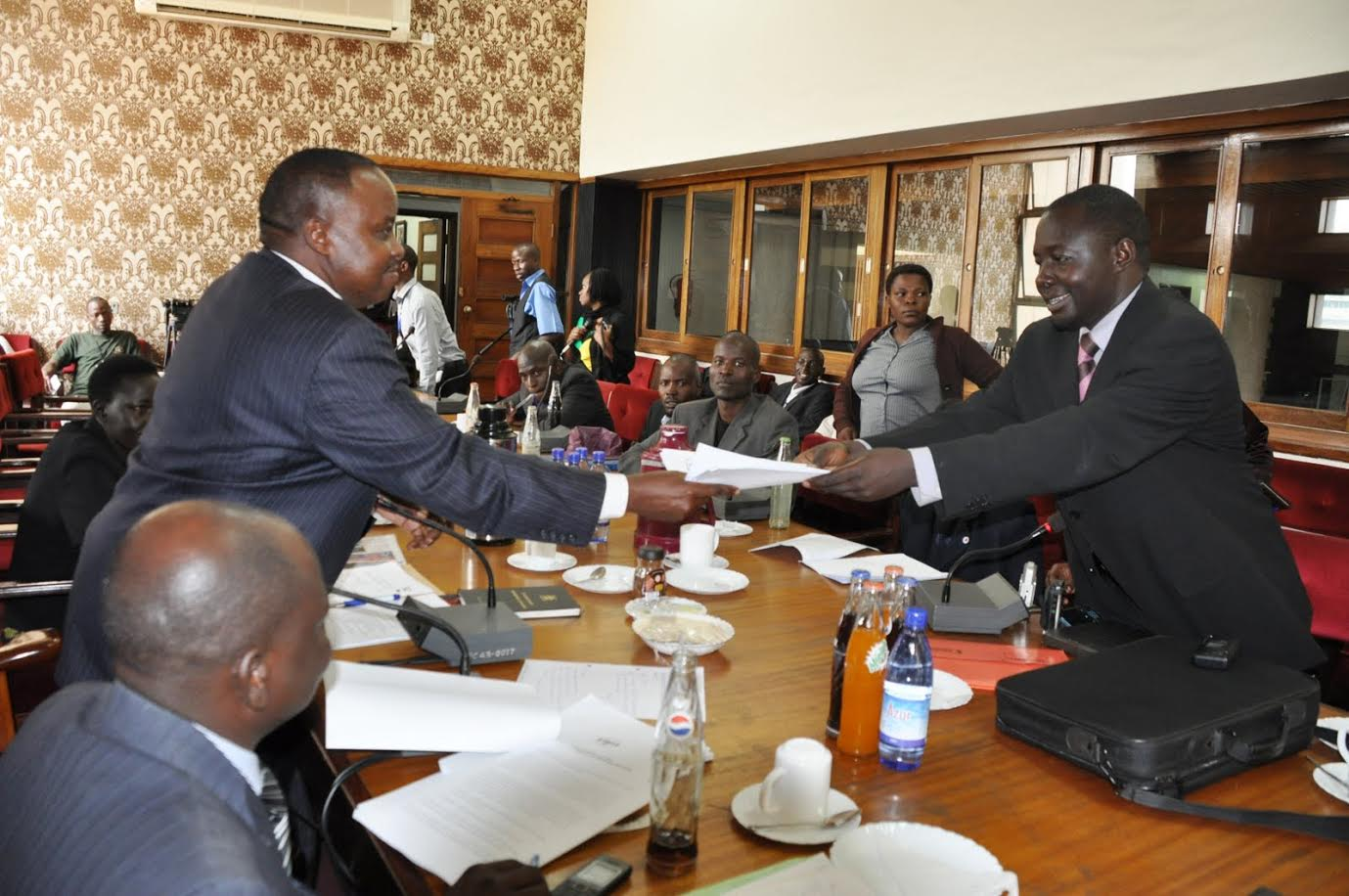 Kikonyogo Kivumbi of the Uganda Health and Science Press Association presents a petition to the parliament's HIV committee. (Photo courtesy of Kikonyogo Kivumbi)