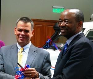 U.S. Ambassador David Bruce Wharton (left) meets with Dr. Owen Mugurungi at last year's launch of an anti-AIDS program in Zimbabwe. (Photo courtesy of U.S. Embassy in Zimbabwe)