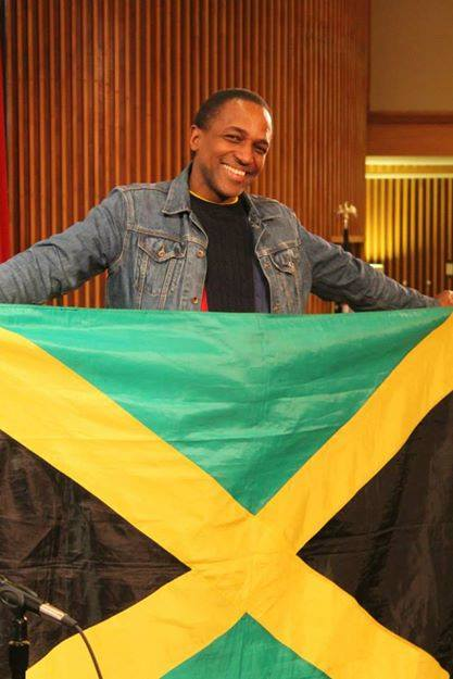 Maurice Tomlinson displays the Jamaican flag. (Photo courtesy of Maurice Tomlinson via Facebook)