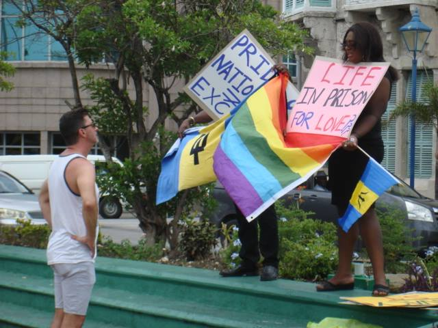 On Aug. 19, in front of the Barbados parliament building, protesters seek the repeal of Section 9 of the Sexual Offences Act in their first Flash Stand for Equality and Inclusion. (Photo courtesy of Maurice Tomlinson)