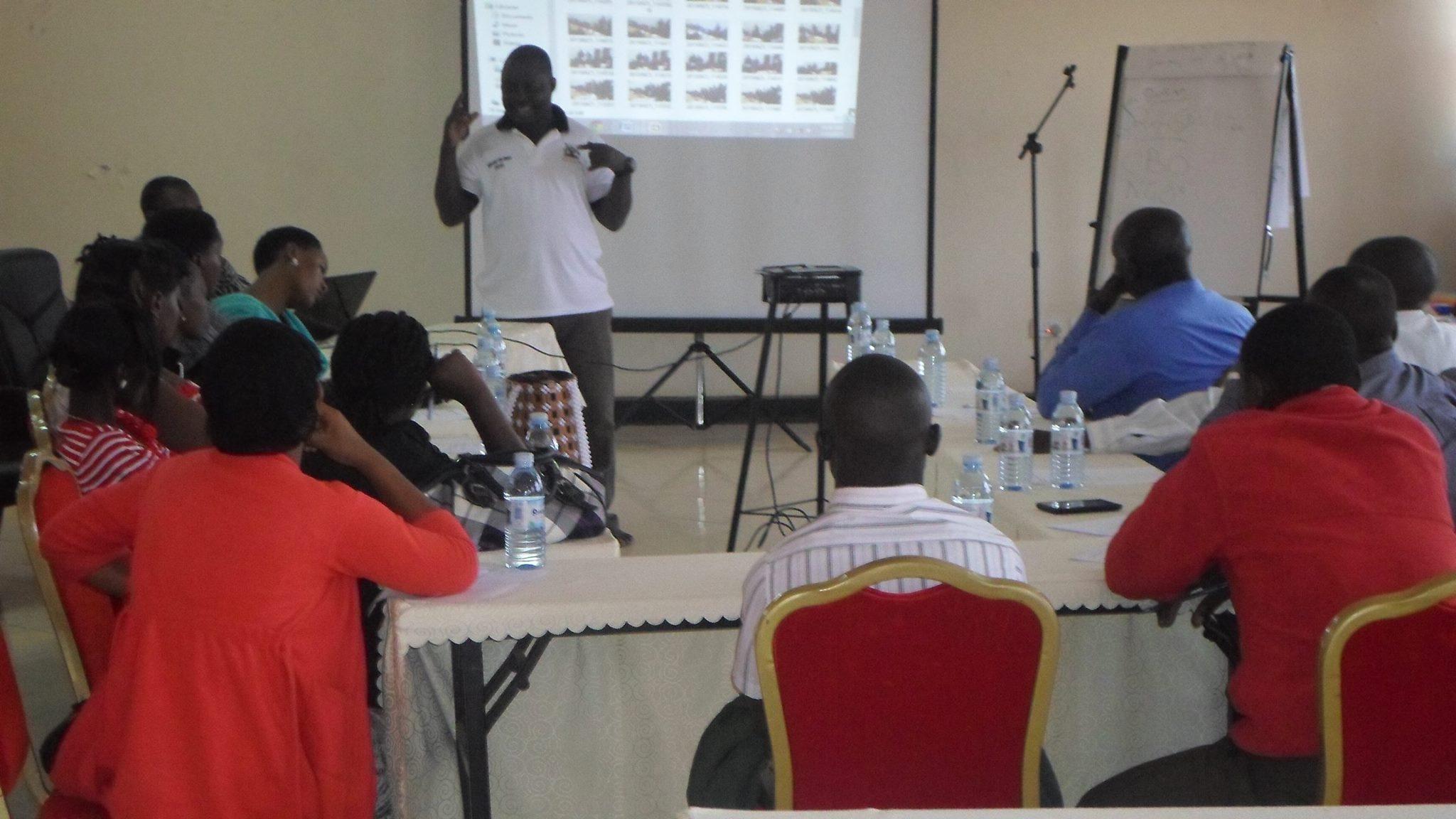 Kiko Kivumbi addresses meeting of key affected populations in Hoima. (Photo courtesy of Kiko Kivumbi)