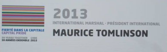 Sign at Ottawa Pride 2015 lists Maurice Tomlinson as the international marshal of the Pride Parade in 2013.