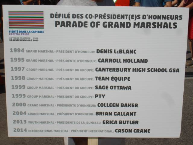 Sign at Ottawa Pride 2015 lists Denis LeBlanc as the grand marshal of the Pride Parade in 1994.
