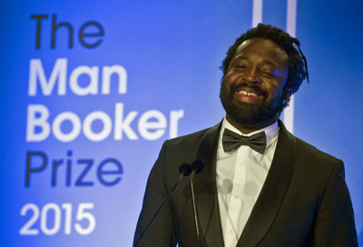 Marlon James celebrates receiving the Man Booker Prize (Photo courtesy of Pink News)