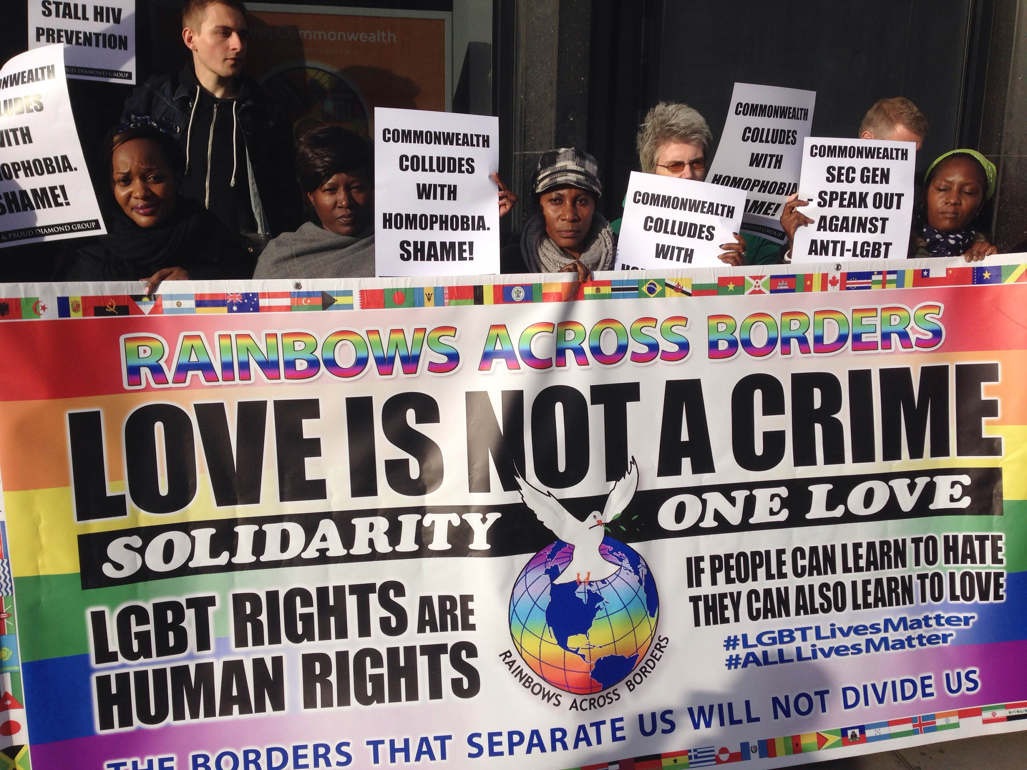 """""""Love Is Not A Crime,"""" say demonstrators in London on Nov. 25, seeking repeal of anti-homosexuality laws. (Photo courtesy of Peter Tatchell Foundation)"""