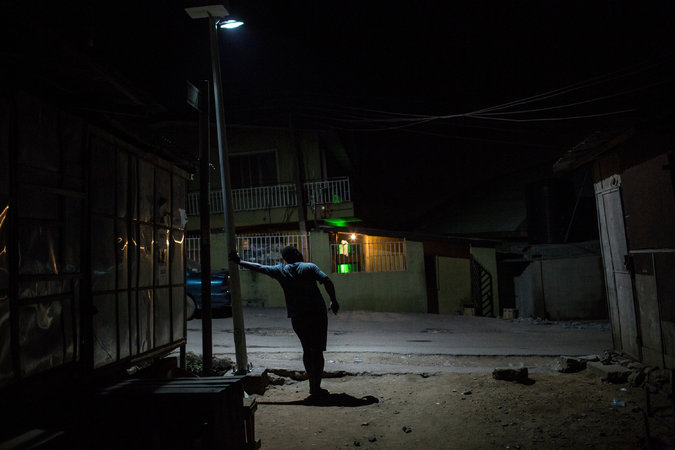 """The New York Times labeled this photo """"A gay man in Bariga, a neighborhood in Lagos, Nigeria, who said he hides his identity from his friends and family."""""""