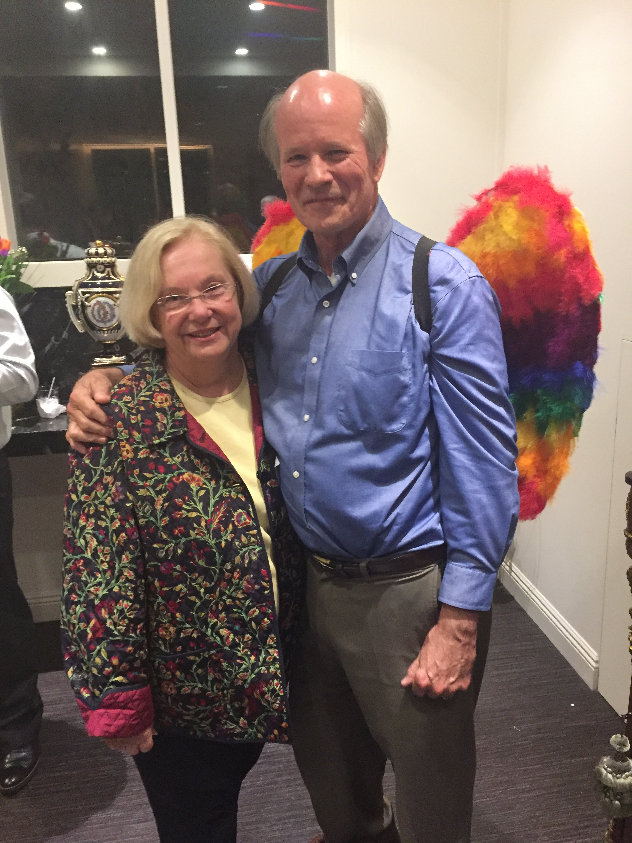 "Colin Stewart, attired in his new ""angel wings,"" with his wife, Sue Stewart."