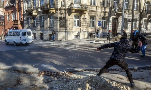 Anti-LGBT rock thrower in Lviv, Ukraine. (Photo courtesy of The Guardian)