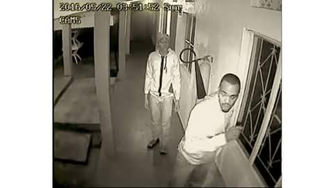 A security camera captured this photo of two of the four burglars who broke into the offices of HRAPF on May 22, 2016, and killed a security guard.