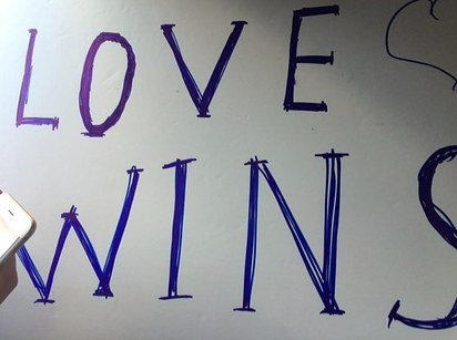 """Love Wins"" sign that led to the arrest of Felix Glyukman and Islam Abdullabeckov (Felix Glyukman photo courtesy of BuzzFeed)"