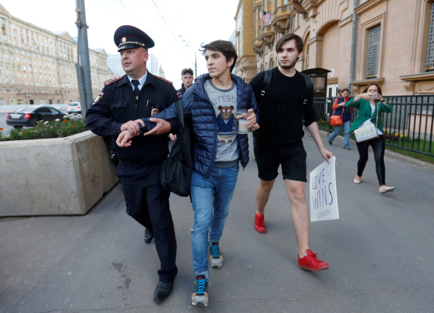 Gay couple arrested in Moscow. (Reuters photo courtesy of BuzzFeed)