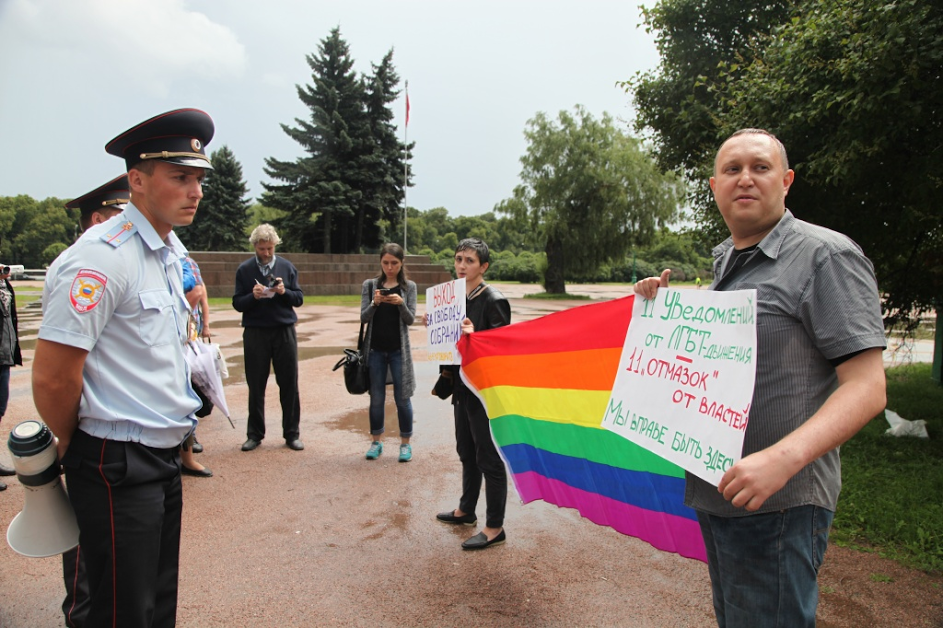 Protesters from Coming Out, shortly before their arrest on July 12 at Marsovo Polye in St. Petersburg, Russia.