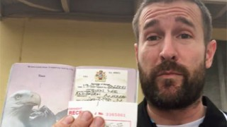 Pastor Steven Anderson displays his 12-month Malawi visa (Photo courtesy of YouTube)