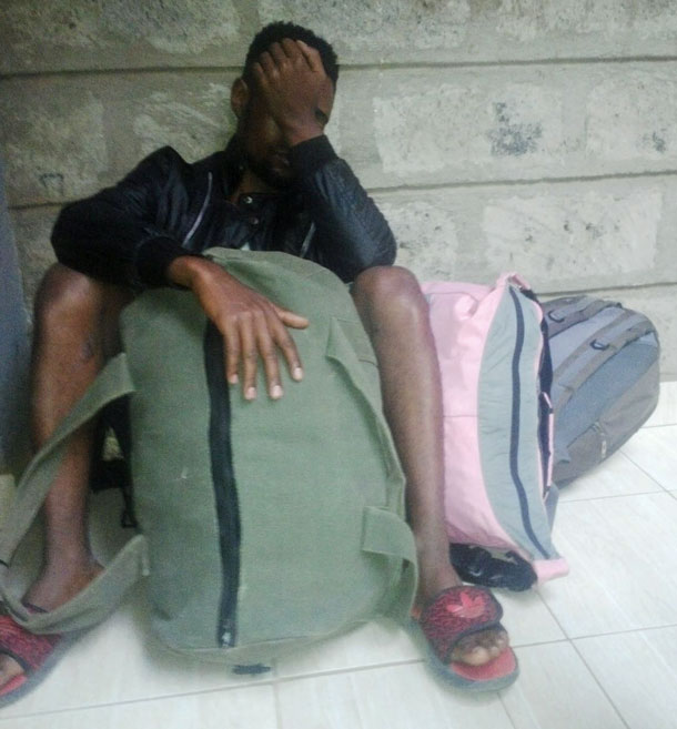 His travel to the U.S. on indefinite hold, Steven sits with his luggage on the veranda of what used to be his home.