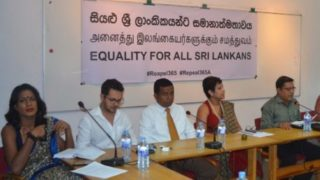 """This month's Sri Lankan press conference on Queer Liberation presented a trans-inclusive gender balance -- four women and four men -- all sitting in front of the banner stating """"Equality for all Sri Lankans"""" in Sinhalese, Tamil and English. (Photo courtesy of Samabima)"""