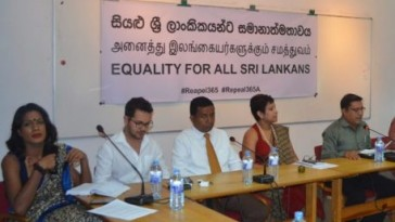 "This month's Sri Lankan press conference on Queer Liberation presented a trans-inclusive gender balance -- four women and four men -- all sitting in front of the banner stating ""Equality for all Sri Lankans"" in Sinhalese, Tamil and English. (Photo courtesy of Samabima)"