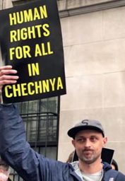 Protester appeals for respect for the LGBT community in Chechnya.