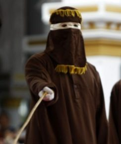 Public caning of a gay couple -- a sharia court's punishment for their homosexual activity -- was carried out May 23 outside a mosque in Banda Aceh, Aceh province, Indonesia.