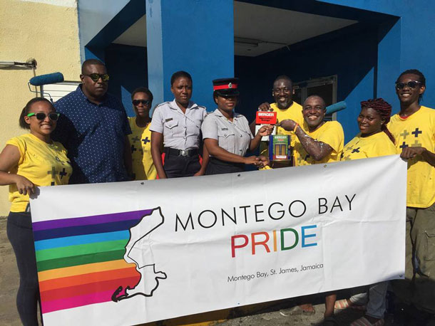 Freeport police and LGBT community members pose together at the police station, the site of Montego Bay Pride's 2017 social service project. (Photo courtesy of Maurice Tomlinson)
