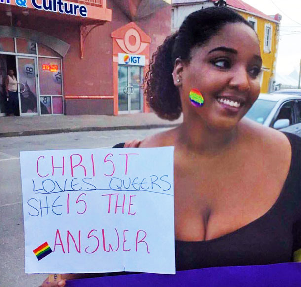 """Counter-protester declares: """"Christ Loves Queers"""" (Photo from Facebook)"""