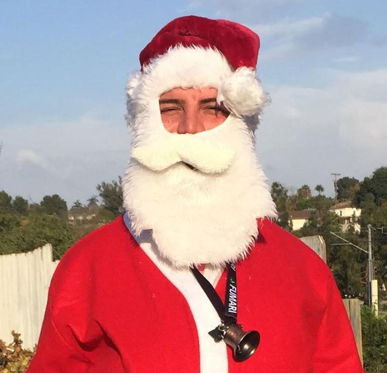 Gay Kurd refugee as Baba Noel in San Diego. (Photo courtesy of Linda Miles)