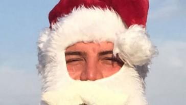 Kurdish refugee Saleh Al-Bayati played Baba Noel this month in San Diego. (Photo courtesy of Linda Miles)