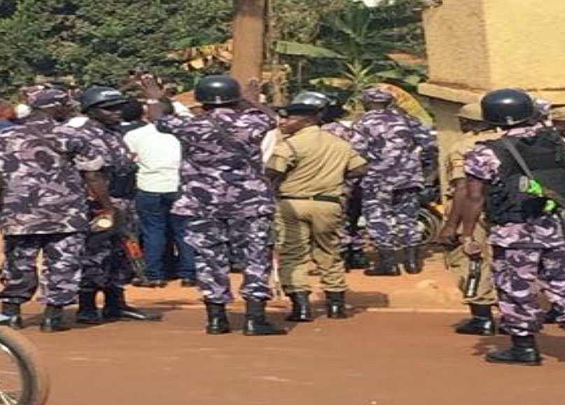 Police officers trying to stop HRAPF staff and partners from participating in the sit-in. (Photo courtesy of HRAPF)
